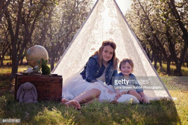 Sisters In Lace Teepee Looking at Camera