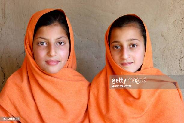 sisters in same dress - amir mukhtar stock photos and pictures