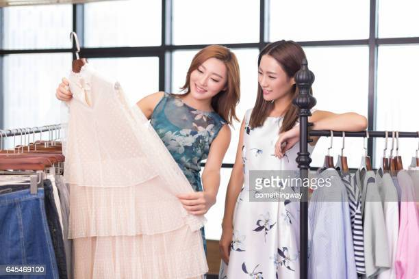 Sisters in the clothing store to buy clothes