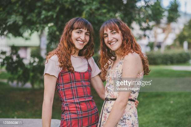 sisters in the park - latin america stock pictures, royalty-free photos & images