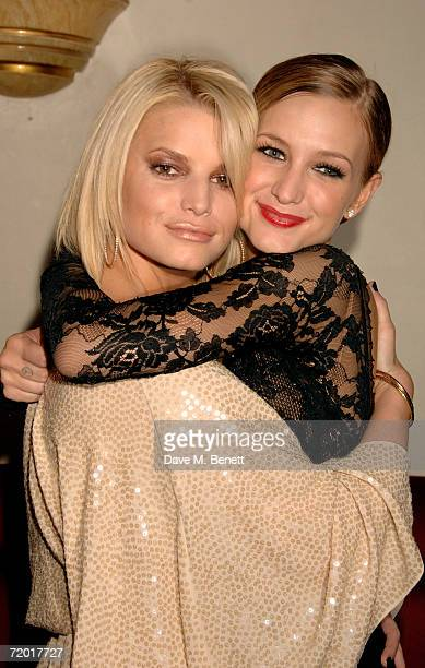 Sisters Jessica and Ashlee Simpson pose backstage after Ashlee Simpson's British stage debut playing Roxie Hart in longrunning musical Chicago at...