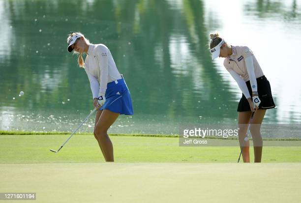 Sisters Jessica and Nelly Korda hit pitch shots to the sixth green during a practice round prior to the ANA Inspiration at the Dinah Shore course at...