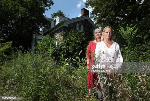 PICKERING ON JULY 31 Sisters kate and Melissa are seen in the overgrown yard of the house After the death of their parents Melissa Preston and Kate...