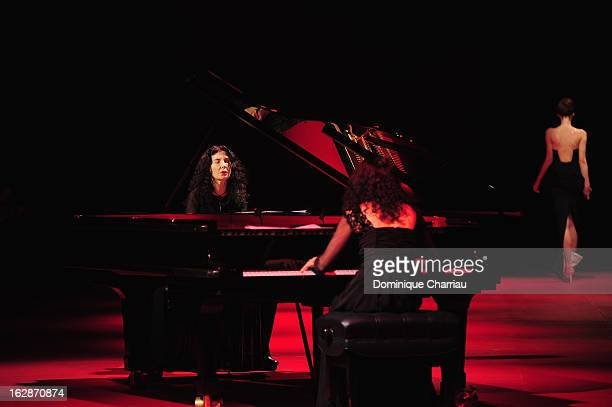 Sisters Katia Labeque and Marielle Labeque perform during Nina Ricci Fall/Winter 2013 ReadytoWear show as part of Paris Fashion Week on February 28...