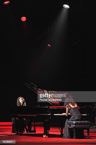 Sisters Katia Labeque and Marielle Labeque perform during the Nina Ricci Fall/Winter 2013 ReadytoWear show as part of Paris Fashion Week on February...