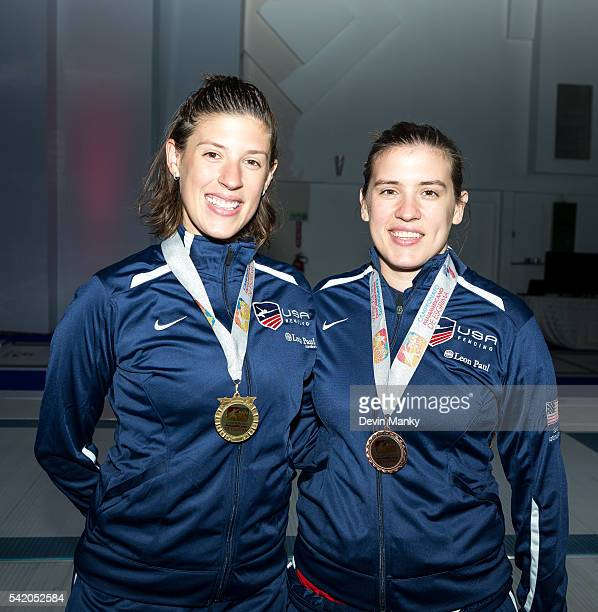 Sisters Kelley and Courtney Hurley show their gold and bronze medals respectively from the Women's Epee event during the PanAmerican Championships at...