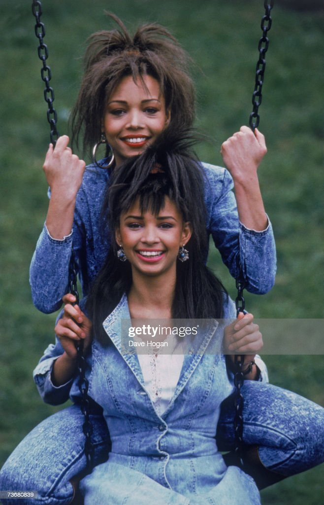 Sisters Kim (top) and Melanie (1966 - 1990) Appleby of English pop singing duo Mel and Kim, 21st April 1987.