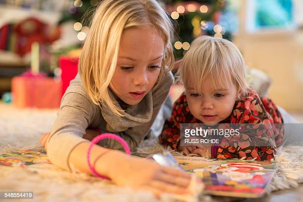 Sisters looking at advent calendar