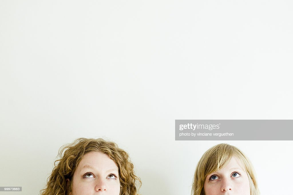 Sisters looking up : Stock Photo
