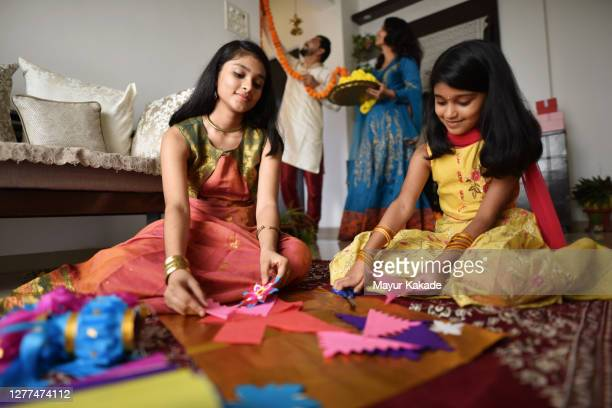 sisters making lanterns out of paper for diwali celebration - art and craft stock pictures, royalty-free photos & images