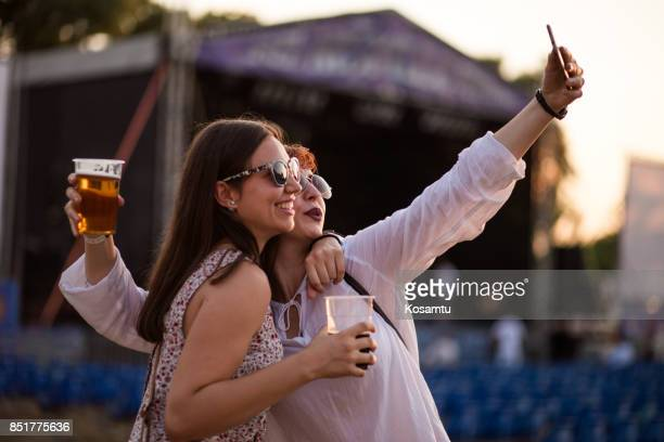 Sisters Making Selfie At Beer Festival