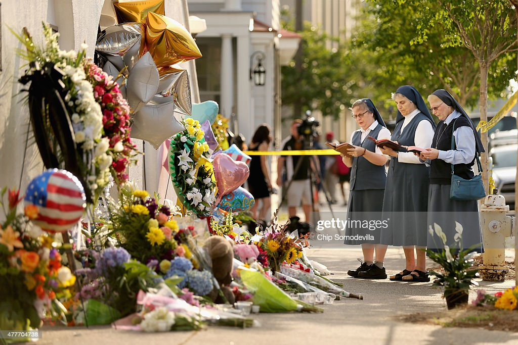 Sisters Margaret Kerry, Mary Thecla and Kathleen Lang of the Order of the Daughters of St. Paul pray outside the historic Emanuel African Methodist Episcopal Church June 19, 2015 in Charleston, South Carolina. South Carolina Governor Nikki Haley called for the death penalty for Dylann Storm Roof, 21, of Lexington, South Carolina, if he is found guilty of murdering nine people during a prayer meeting at the church Wednesday night. Among the dead is the Rev. Clementa Pinckney, the pastor of the church which, according to the National Park Service, is the oldest black congregation in America south of Baltimore.