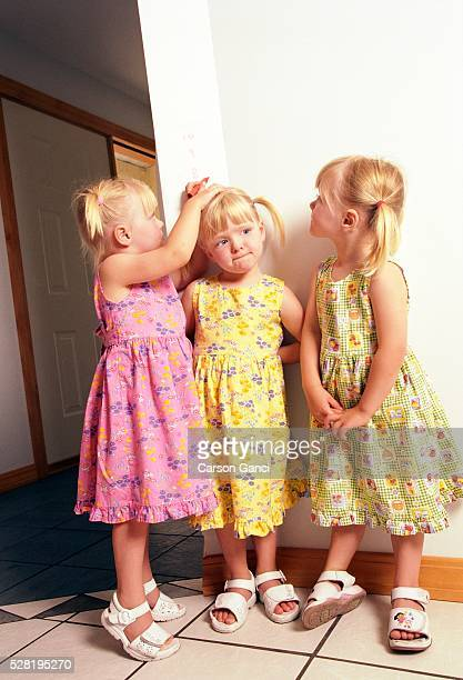 Sisters Measuring their Height