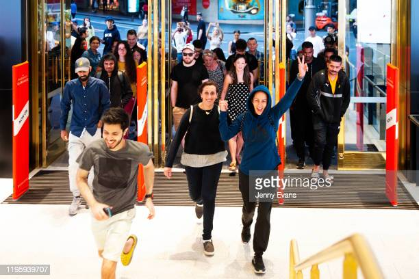 Sisters Nasrin Baydoun and Sawsun Mouhanna cheer as they run through the doors of the David Jones Elizabeth Street store for the 6am opening during...