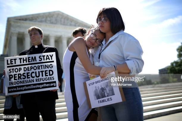 Sisters Nicole Edralin and Michelle Edralin from Highland Park New Jersey whose father Cloyd Edralin was apprehended by ICE agents console one...