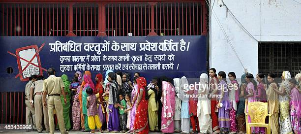 Sisters of inmates went to meet their brothers on occasion of Raksha Bandhan at Dasna Jail on August 10 2014 in Ghaziabad India The festival of...