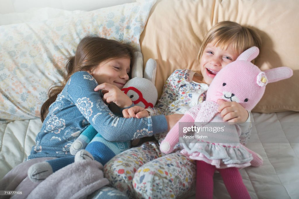 Sisters on bed : Stock Photo