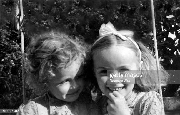 Sisters on garden swing