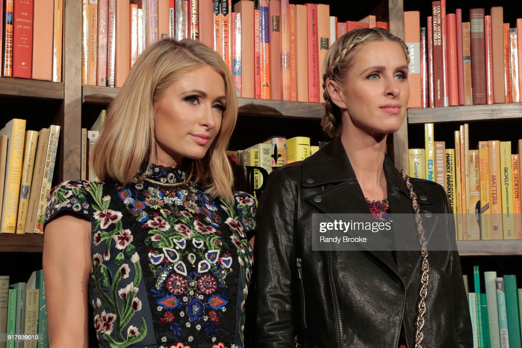 Sisters Paris Hilton (l) and Nicky Hilton-Rothschild attend the Alice + Olivia By Stacey Bendet - Presentation - February 2018 - New York Fashion Week: The Shows at Industria Studios on February 13, 2018 in New York City.