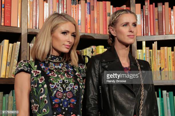 Sisters Paris Hilton and Nicky HiltonRothschild attend the Alice Olivia By Stacey Bendet Presentation February 2018 New York Fashion Week The Shows...