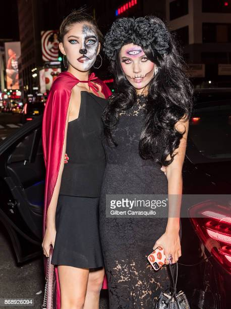 Sisters Paulina Swarovski and Victoria Swarovski are seen during Heidi Klum's 18th Annual Halloween Party at Magic Hour Rooftop Bar Lounge on October...