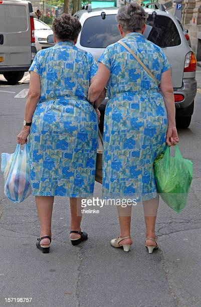 sisters - fat granny stock pictures, royalty-free photos & images