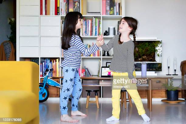 sisters playfighting in the living room - girl wrestling stock pictures, royalty-free photos & images