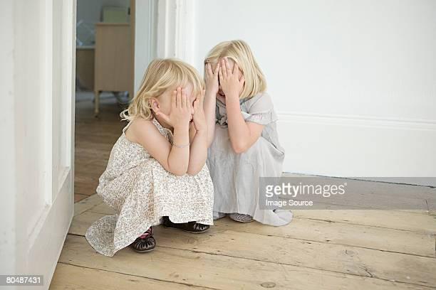 Sisters playing hide and seek