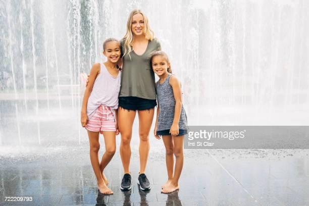 Sisters posing near fountain