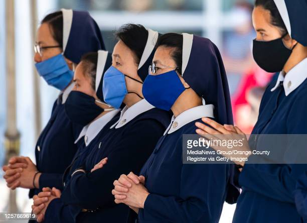 Sisters pray during an outdoor mass at Christ Cathedral in Garden Grove on Sunday, July 19, 2020. Services at Christ Cathedral have been moved...