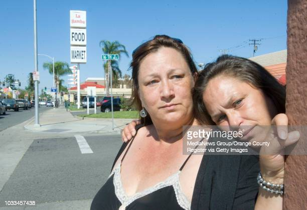 Sisters Rita Gomez at left and Dolores Gomez stand on Main and 16th streets in Santa Ana where their mom Adriesue Bitzy Gomez was hit by a car and...