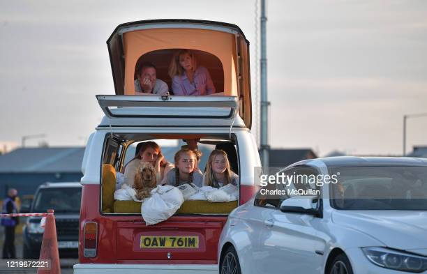 Sisters Rosie Grace and Alex McQueen along with their parents and dog Molly watch Grease on the big screen in the Titanic Quarter from their classic...