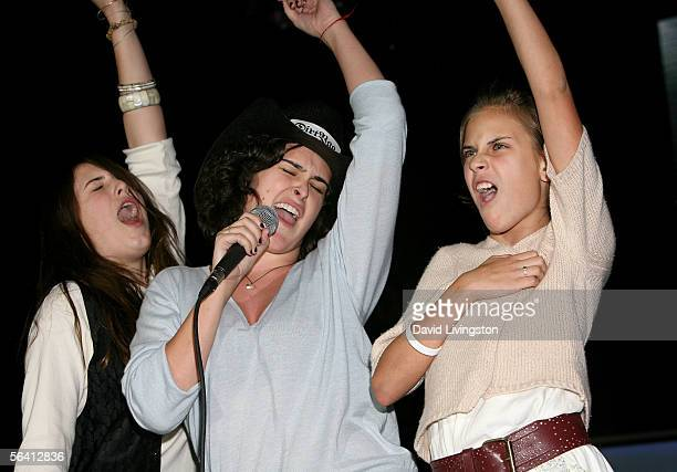 Sisters Scout Willis Rumer Willis and Tallulah Willis perform onstage during Playstation Bandtogether a benefit presented by Sony and the Bruce...