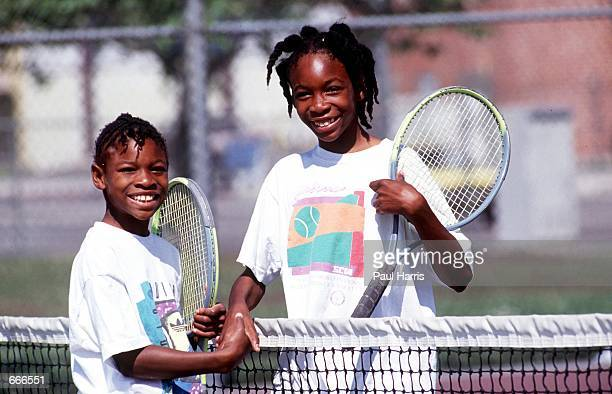 Sisters Serena left and Venus Williams shake hands after a game 1991 in Compton CA Serena and Venus Williams will be playing against each other for...