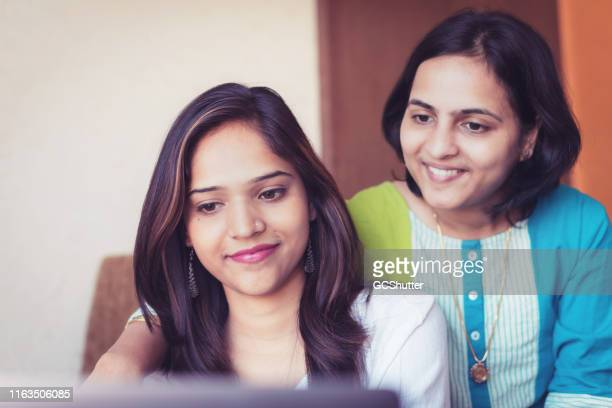 sisters shopping online at home - social media marketing stock pictures, royalty-free photos & images