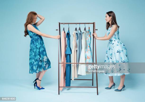 sisters show clothes - dress stock pictures, royalty-free photos & images