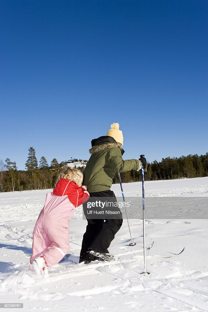 Sisters skiing Sweden. : Stock Photo