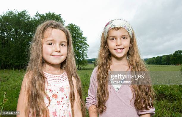 Sisters smiling in a field