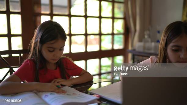 sisters studying together at home - mindzoom 2 stock pictures, royalty-free photos & images