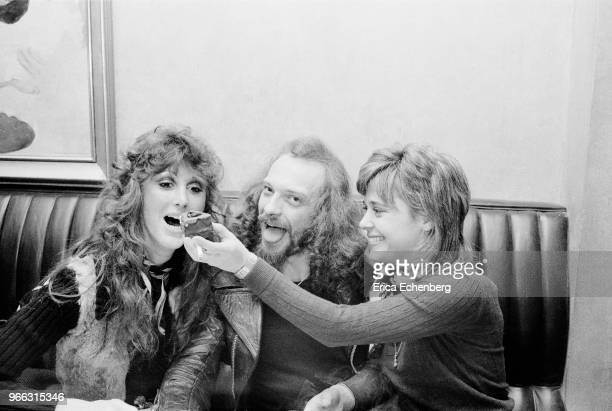 Sisters Suzi Quatro and Patti Quatro with Ian Anderson of Jethro Tull at an after show party at Burke's Restaurant in Mayfair London 1974