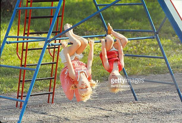 sisters swinging upside down - 1967 stock pictures, royalty-free photos & images