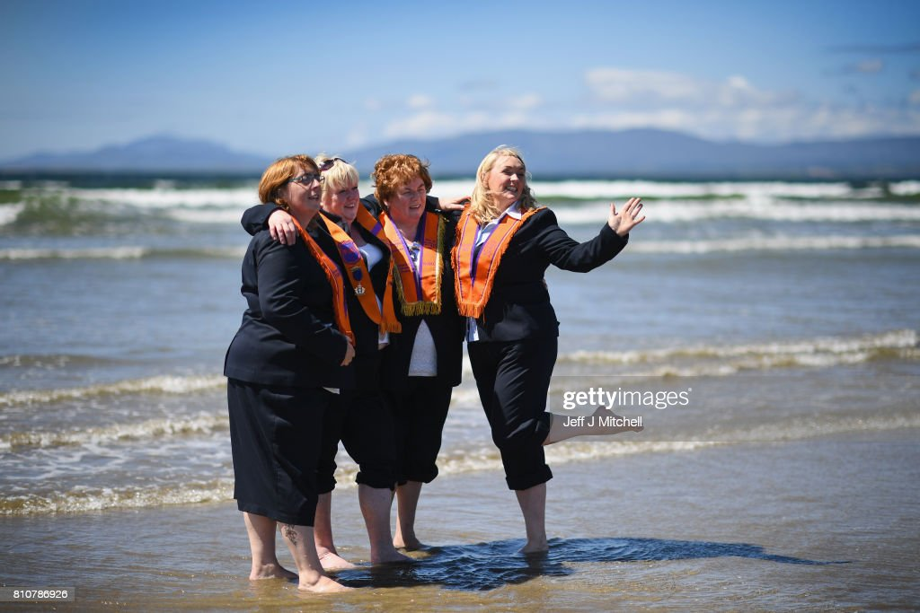 Sisters take a walk onto the beach as they take part in the annual pre Twelfth of July Orange parade held in Rossnowlagh on July 8, 2017 in Donegal, Ireland. The demonstration in Rossnowlagh is traditionally held the Saturday before the Twelfth of July parades across the border in the north of Ireland. The annual Orange marches and demonstrations celebrate the Battle of the Boyne in 1690 when the Protestant King William of Orange defeated the Catholic King James II on the banks of the river Boyne.