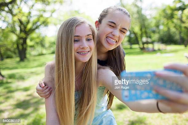 sisters taking a selfie - little girl sticking out tongue stock photos and pictures