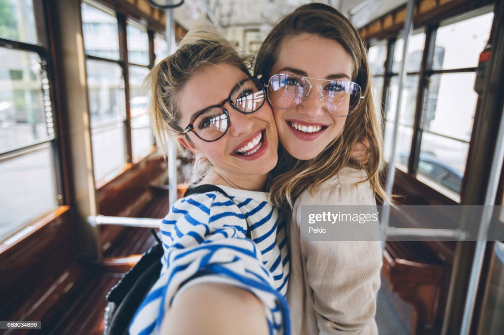 Sisters taking selfie in vintage tram : Stock-Foto