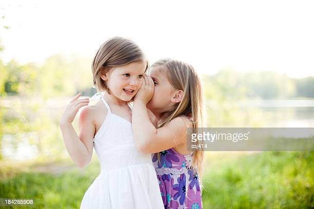 Sisters telling secrets