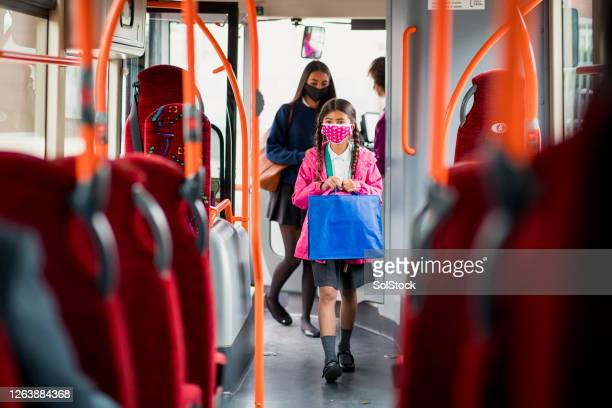 sisters using public transport during a pandemic - school child stock pictures, royalty-free photos & images