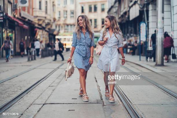 sisters walking together - open toe stock pictures, royalty-free photos & images