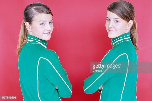 Sisters Wearing Green Jackets