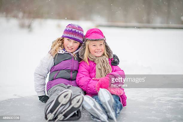 Sisters Wearing Ice Skates