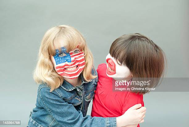 Sisters with painted flag faces
